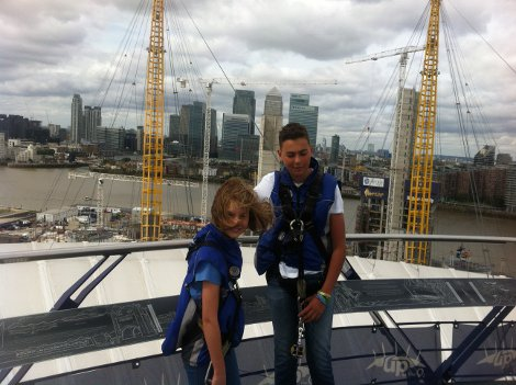 Wearing the safety harness when climbing the O2