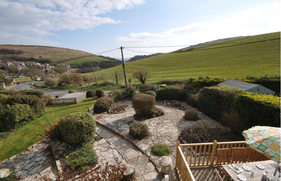 Advantage Point has a paved garden with views over the Dorset landscape