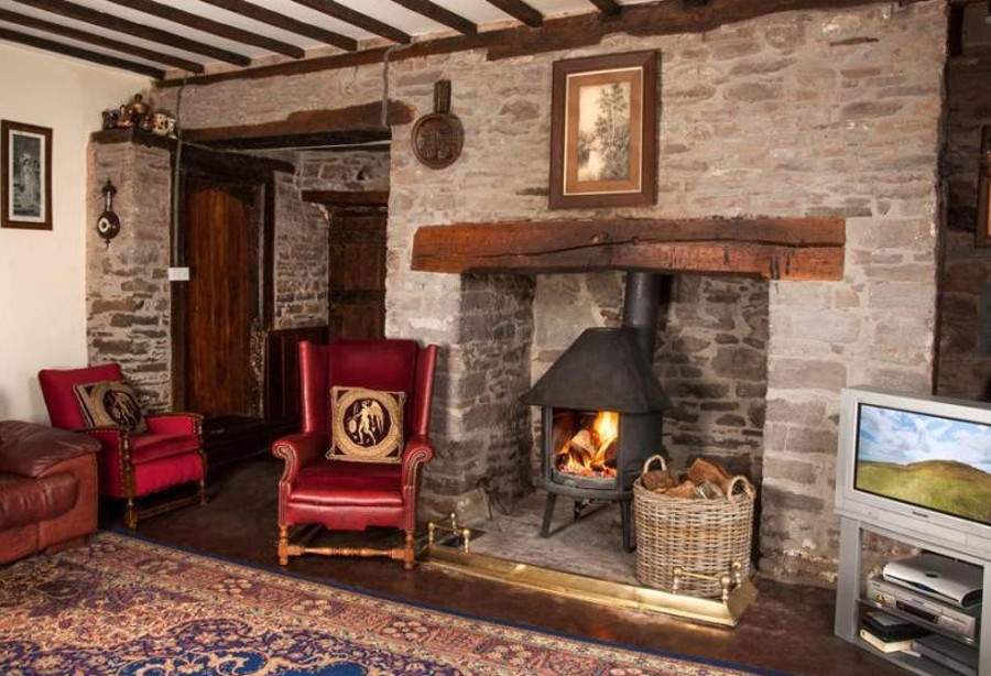 The living room at Alexanderstone Manor has a wood burning stove