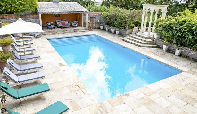 The outdoor swimming pool at Amberstone Manor in Devon