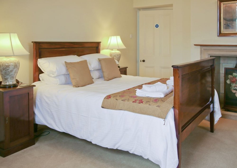 One of the bedrooms at Higher Brownstone Farmhouse in Kingswear