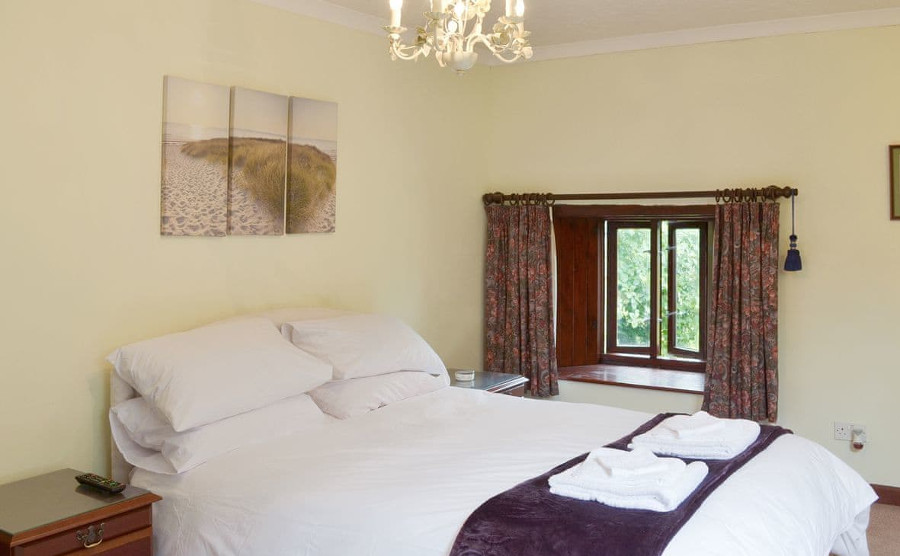 One of the two double bedrooms at Bolberry Court in Devon. There is also a single bedroom