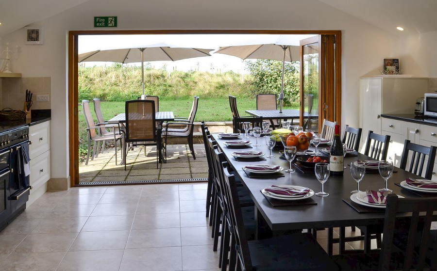 The kitchen and dining area, with views of the great outdoors, at Buckland Barn