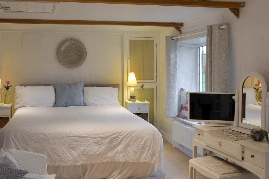 One of the five bedrooms at Candlelight Cottage in Littlehempston, Devon
