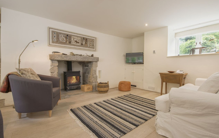 The living room with its wood burning stove at Cullaford Cottage in Devon