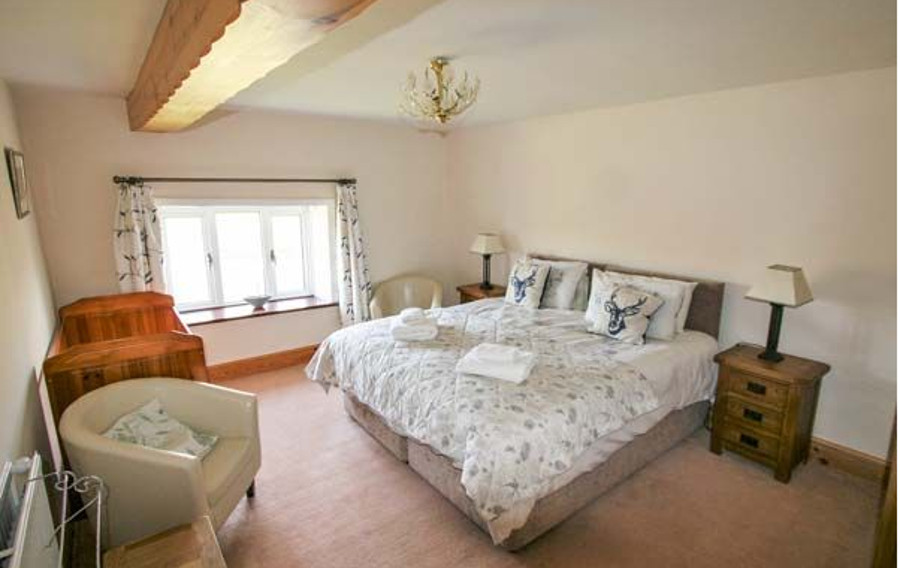 One of the six bedrooms at Deer Close West Farmhouse in Horsehouse