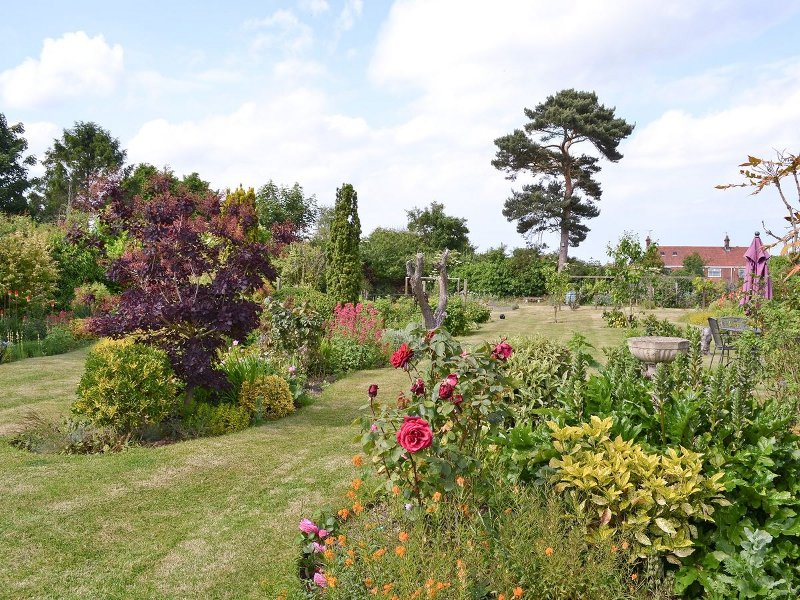 The large garden at Dormers - ideal for making the most of the Norfolk countryside