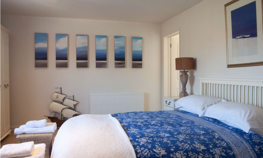 One of the four bedrooms at Eastwood House in Brancaster