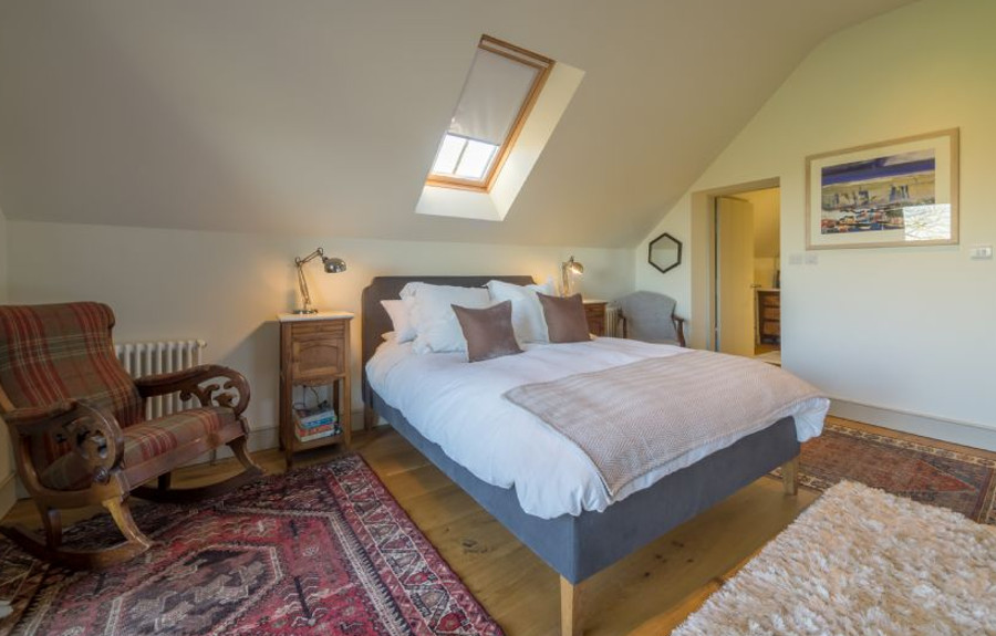 One of the five bedrooms at Ellis Farm Barn in Field Dalling