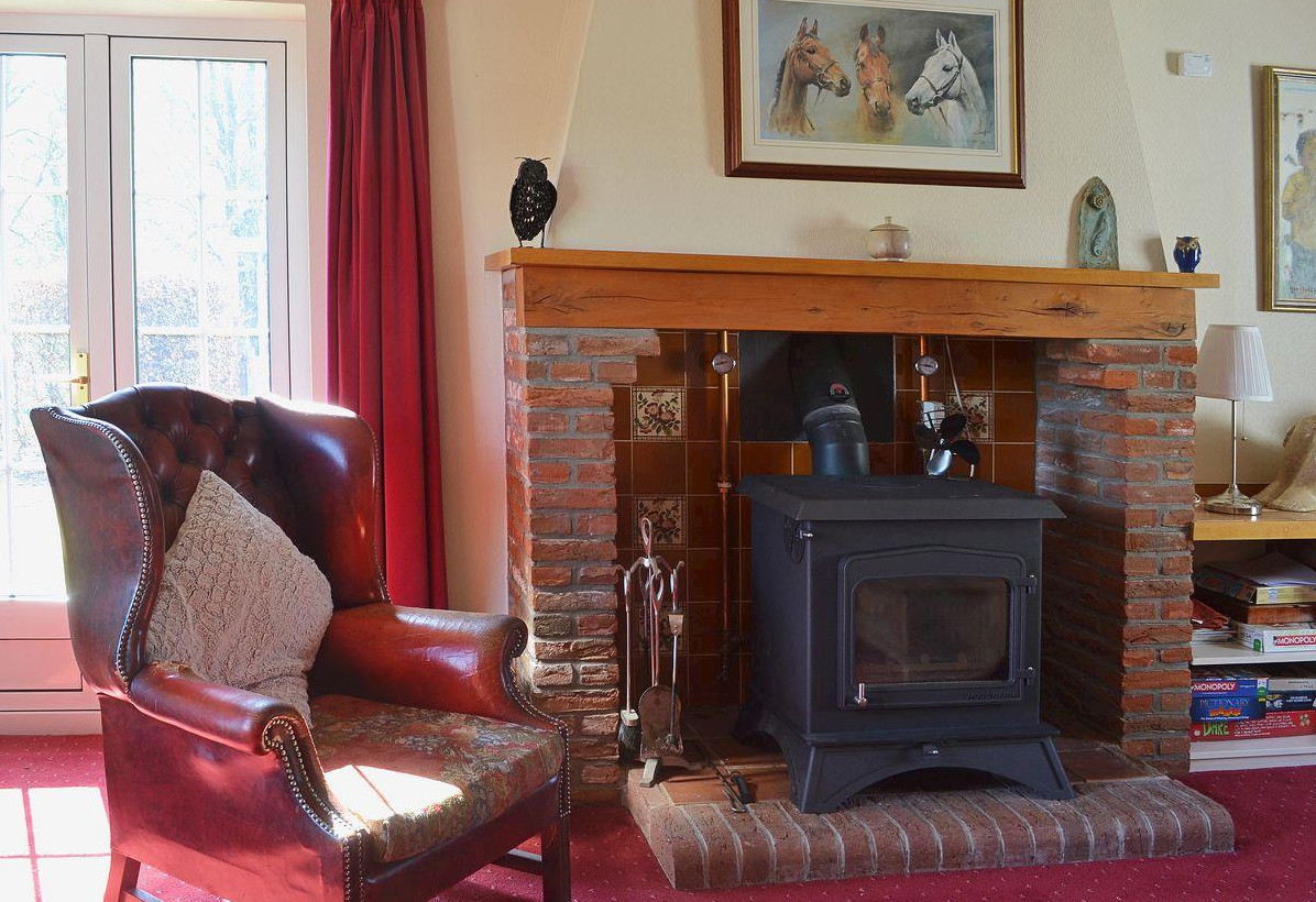 Sit by the wood burning stove in Fox Hill Cottage, nesr Inverness