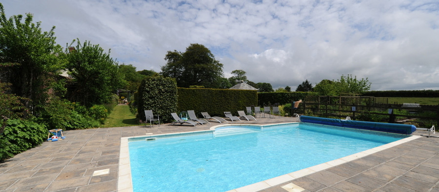 The swimming pool at Glebe House Cottages in Devon