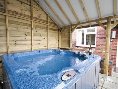 Enjoy the hot tub at Green Haven Lodge
