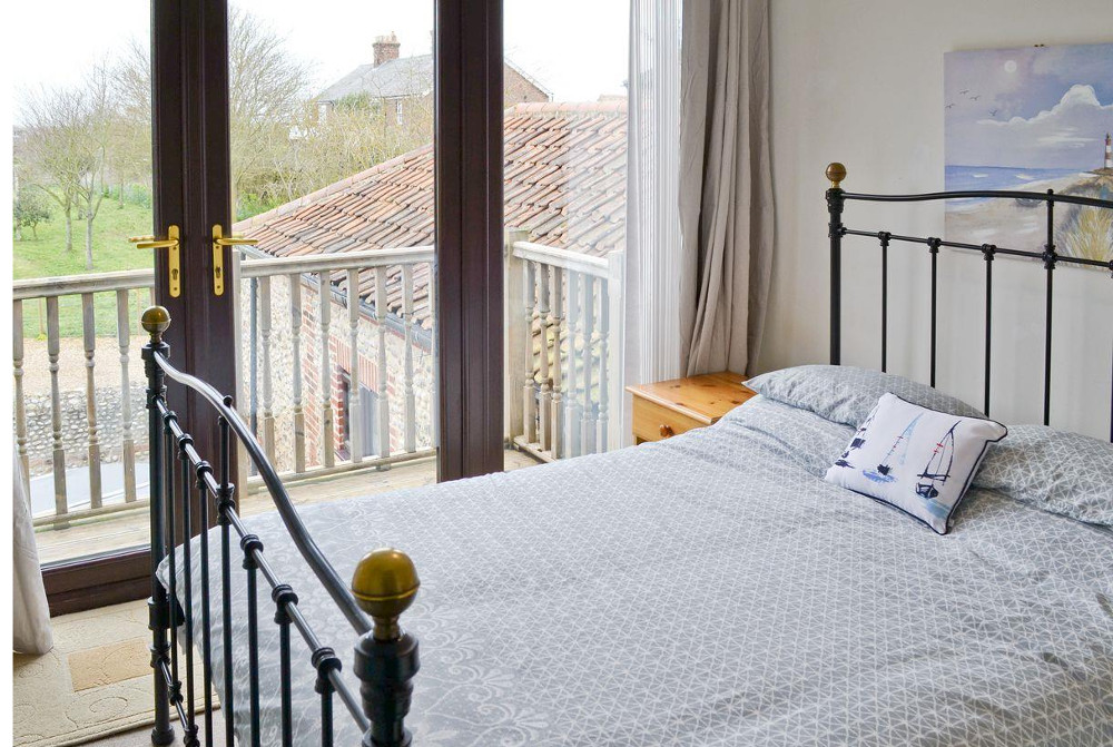 One of the four bedrooms at Gull Cottage near Blakeney, Norfolk