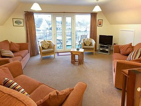 The living room at Heron - Daisy Broad Lodges