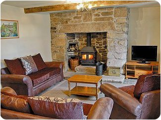 Relax by the wood burning stove at<br />Higher Thorne Cottage
