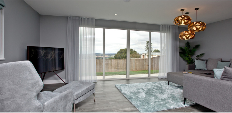 The living room at Huxham View. You also have a cinema room, pool room and a gym!