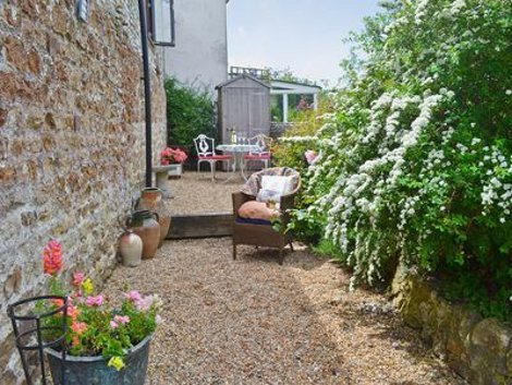 The courtyard garden at Jolly Fisherman Cottage near Selsey