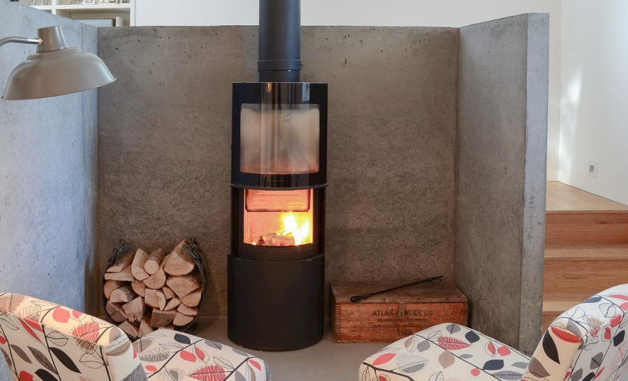 Relax in front of the wood burning stove at Kirk House in Garve