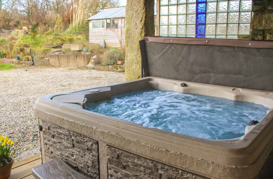 After a day exploring Cornwall, you can return to Lanxton Barn to relax in the hot tub