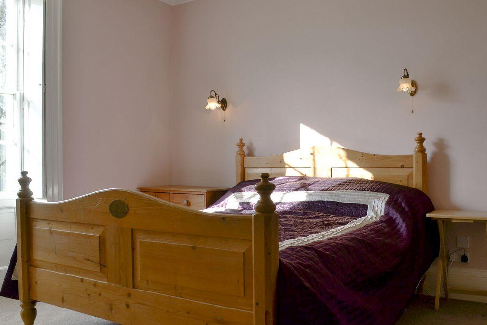 One of the 9 bedrooms at Lode Hall, Norfolk