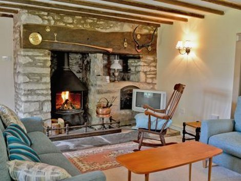Snuggle up in front of the wood burning stove at Maes-yr-Adwy