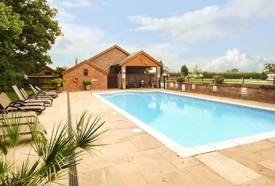 You have shared use of the outdoor swimming pool at Manor Wood in Coddington