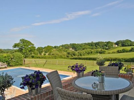 The garden and swimming pool at Marley Mount Farm