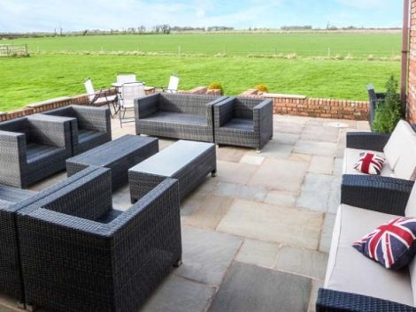 Enjoy the views on the patio at Marsh Farm