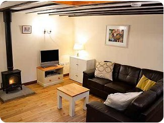 The living room at Newcourt Barn,<br />with the wood burning stove!