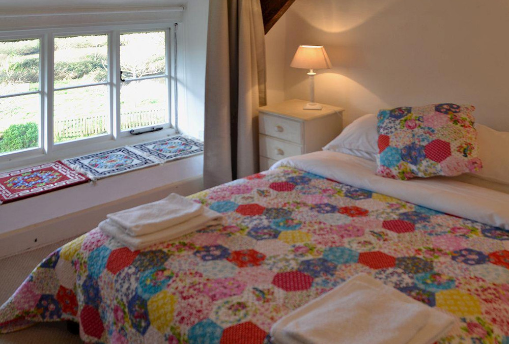 One of the six bedrooms at North End Farm House, Dorset