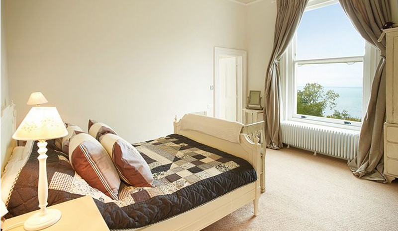 One of the eight bedrooms - this one has a sea view
