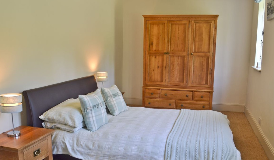 One of the five bedrooms at Pigeon Coo Farmhouse, Isle of Wight