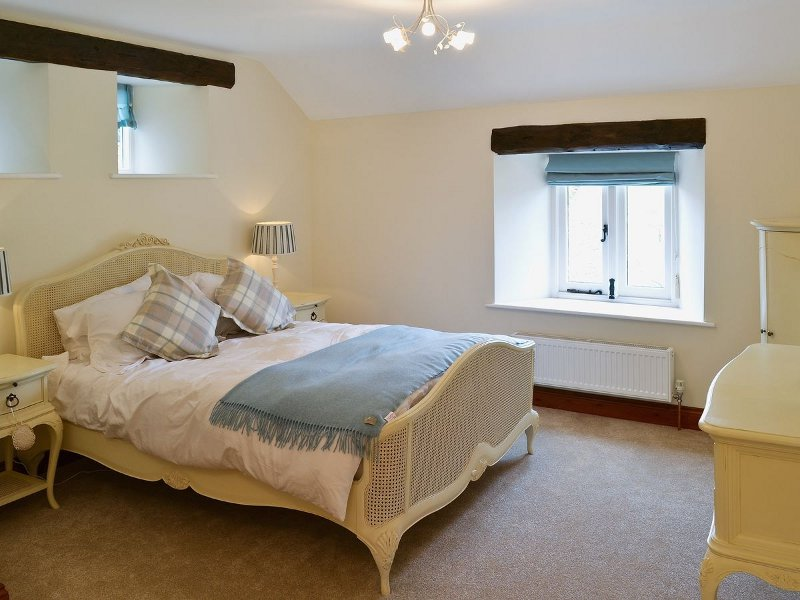 One of the bedrooms at Plane Tree Barn near Holt