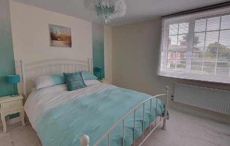 One of the bedrooms at River End Cottage in Beccles