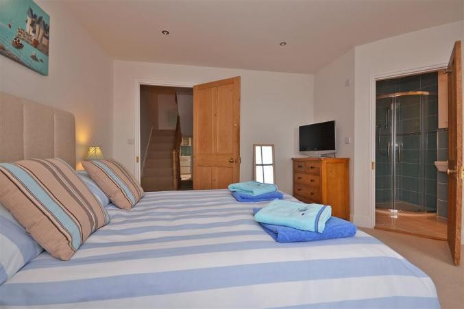 One of the four bedrooms at Shingle House in Torcross