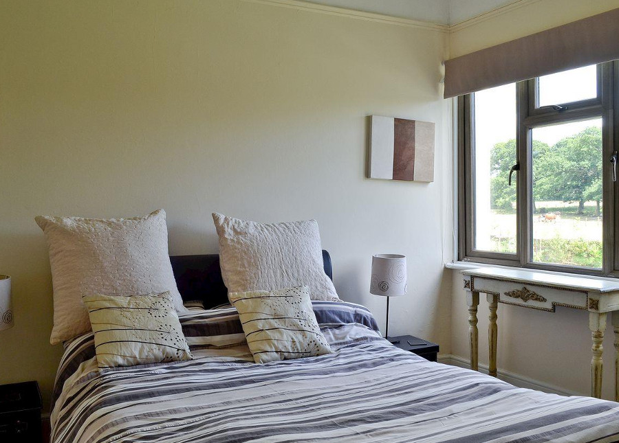 One of the three bedrooms at Shrover Hall in Denmead