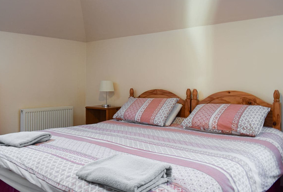 Stables at Benarty Holiday Cottages has three bedrooms, this is the double