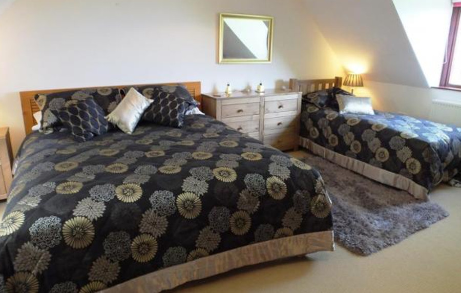 One of the five bedrooms at The Dingle in Freshwater East