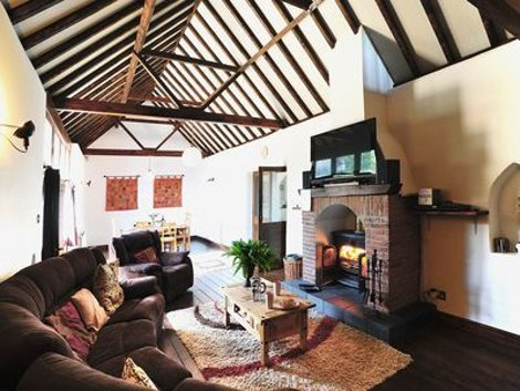 The living room and wood burning stove at The Old Barn