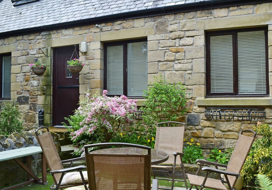 The Old Forge has a small garden with a patio and furniture