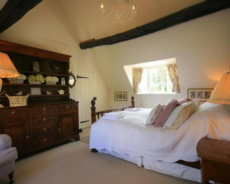 A bedroom at The Old Forge Cottage, near Broadway