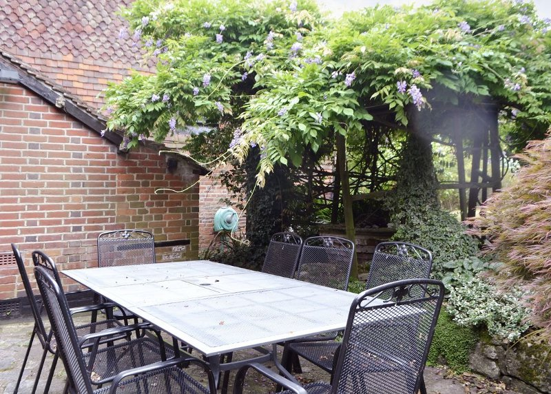 Part of the garden, and seating area, at The Old House near Southampton