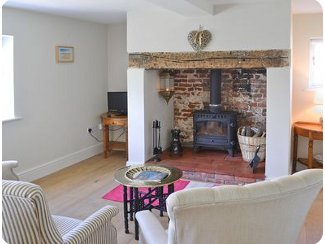 Snuggle up round the wood burning stove at<br />The Old Rectory