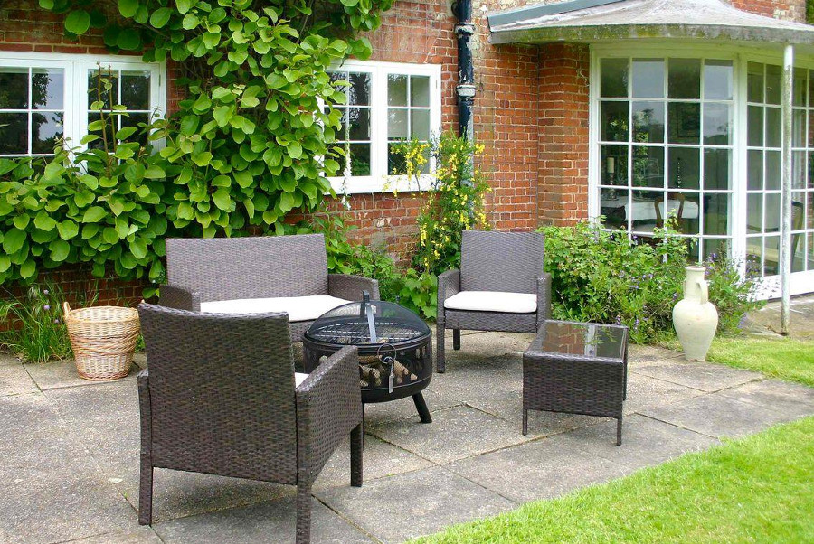The patio with outdoor furniture at The Old Rectory in Norfolk