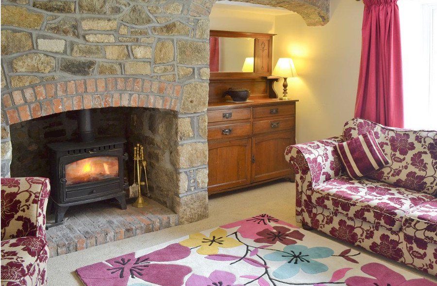 The wood burning stove in the sitting room at The Old Vicarage near Penzance