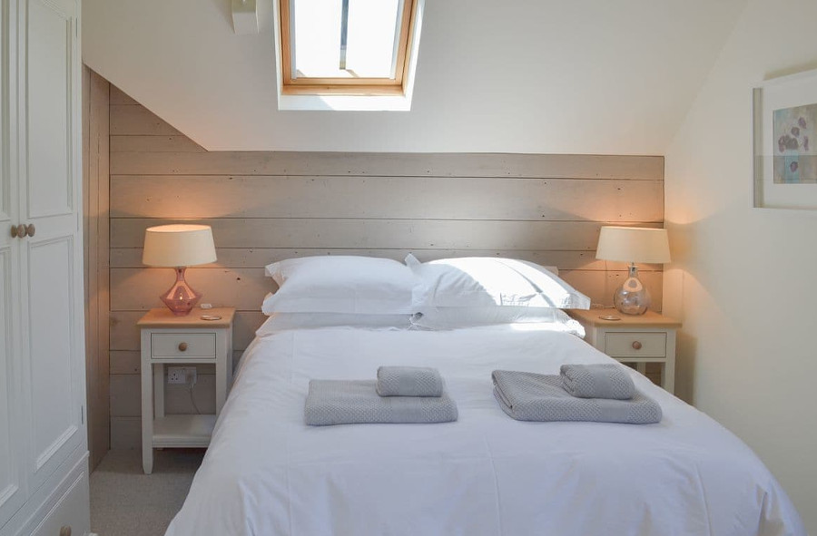 The king-size bed in The Piglet, Devon