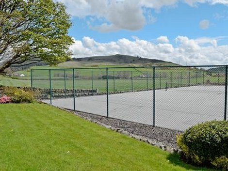 The tennis court and views at The Wee Byre