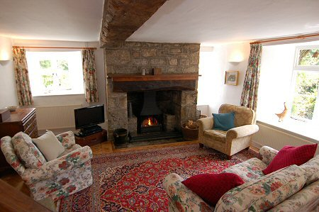 The living room and wood burning stove at Thorn Cottage
