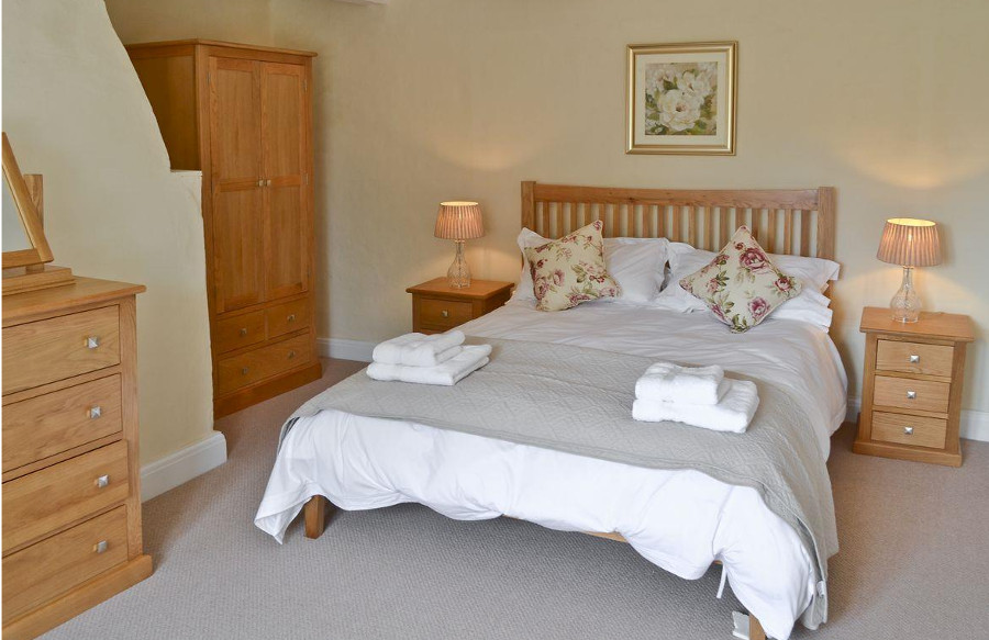 One of the six bedrooms at Three Horseshoes House in Norfolk