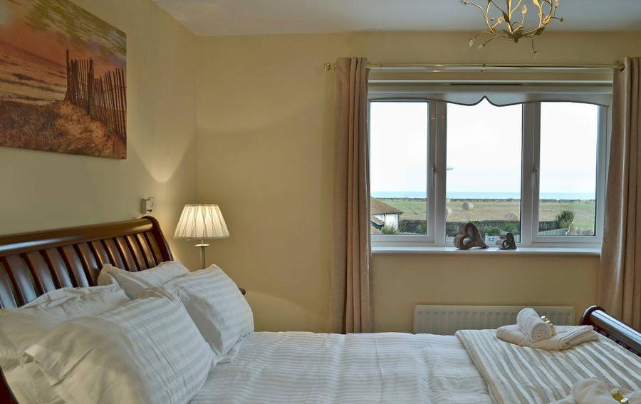 One of the four bedrooms at Tilly-Ho in Seahouses - with sea views!